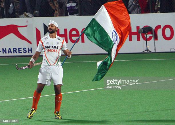 India's Sandeep Singh celebrates after winning the men field hockey match between India and France for the final position of the FIH London 2012...