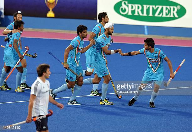 India's Sandeep Singh celebrates his goal with teammates against Britain during a third place playoff match at the Sultan Azlan Shah Cup men's field...