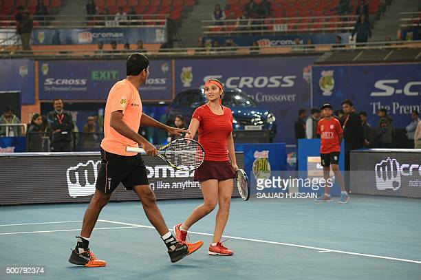 India's Sania Mirza of the Indian Aces and teammate India's Rohan Bopanna speak during the International Premier Tennis League tennis match between...