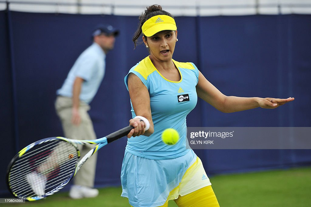 Indias Sania Mirza plays a forehand during her women's doubles match with partner Liezel Huber of the US against Britain's Heather Watson and Croatia's Darija Jurak on the fourth day of the AEGON International tennis tournament in Eastbourne, southern England on June 18, 2013.