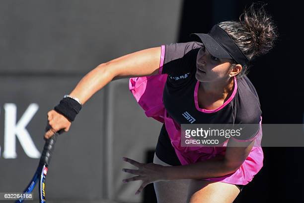 India's Sania Mirza serves against Germany's Laura Siegemund and Croatia's Mate Pavic during their mixed doubles first round match on day six of the...