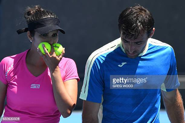 India's Sania Mirza speaks with Croatia's Ivan Dodig during their mixed doubles quarterfinal match against Canada's Gabriela Dabrowski and India's...
