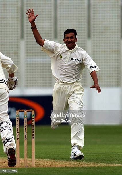 India's Sanjay Bangar dismisses New Zealand's Lou Vincent for 12 on the first day of the first cricket test at the Basin Reserve Wellington Thursday...