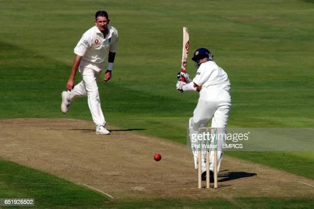 India's Sanjay Bangar hits a bounday off the bowling of England's Andrew Caddick