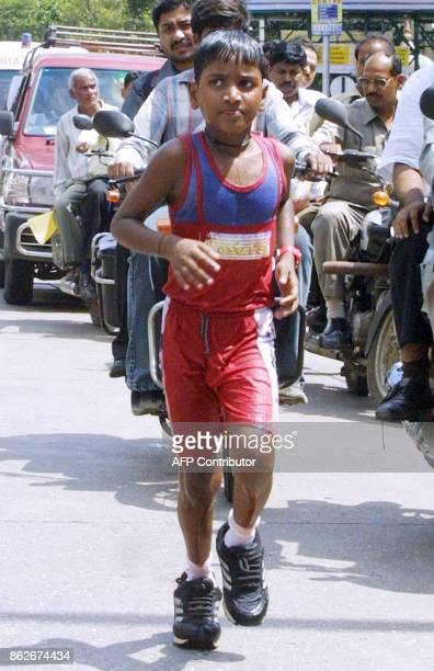 India's second long distance runner and child prodigy Mrutunjaya Mandal Akash runs along the eastern express in Mumbai 24 September 2006 Akash later...