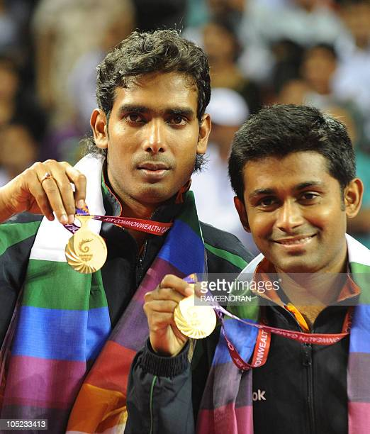 India's Sharath Kamal Achanta and Subhajit Saha hold their gold medal during the medal ceremony for the table tennis men's doubles at the Yamuna...