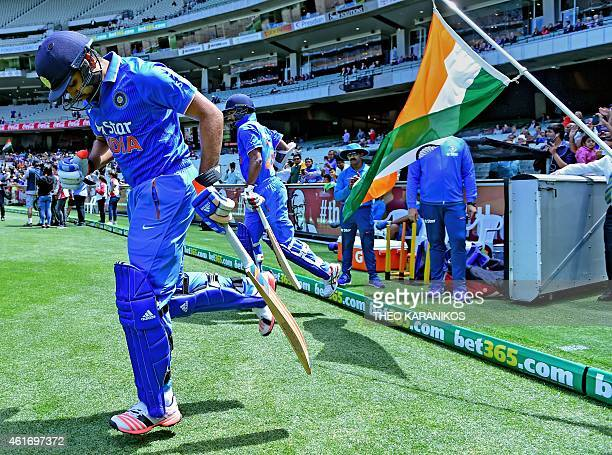 India's Shikhar Dhawan and India's Rohit Sharma enter the field of play to open up the batting during the oneday international cricket match between...