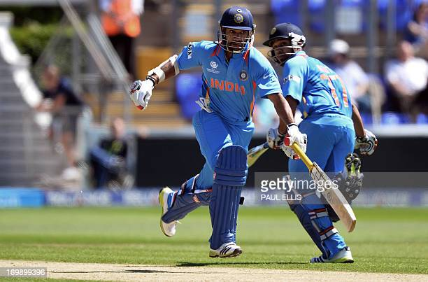 India's Shikhar Dhawan and Rohit Sharma run between the wickets during the warmup cricket match ahead of the 2013 ICC Champions Trophy between India...