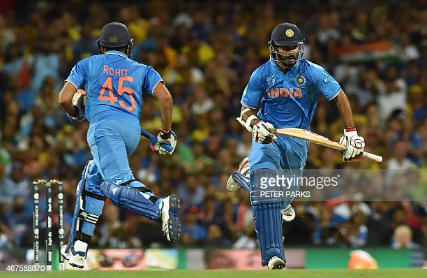 India's Shikhar Dhawan and Rohit Sharma run between the wickets during the 2015 Cricket World Cup semifinal match between Australia and India in...