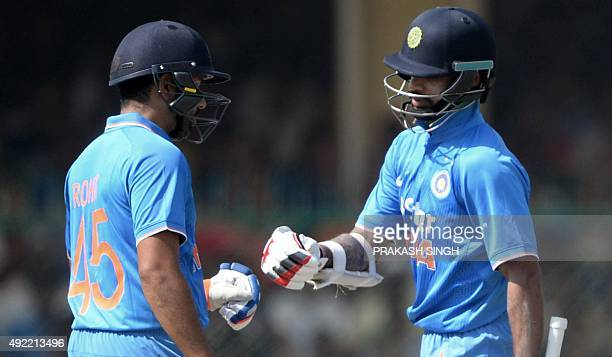 India's Shikhar Dhawan and teammate Rohit Sharma celebrate a boundary during the first one day international cricket match between India and South...
