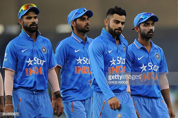 India's Shikhar Dhawan Bhuvneshwar Kumar Virat Kohli and Ajinkya Rahane leave the field after their teams loss in the oneday international cricket...