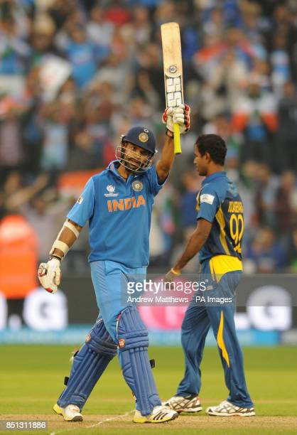 India's Shikhar Dhawan celebrates reaching 50 runs during the ICC Champions Trophy Semi Final at the SWALEC Stadium Cardiff