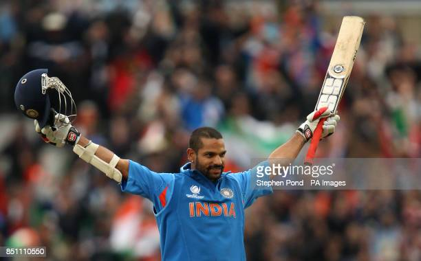 India's Shikhar Dhawan celebrates reaching his century during the ICC Champions Trophy match at the Kia Oval London