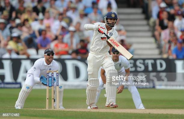 India's Shikhar Dhawan hits the ball straight back to England bowler Moeen Ali and is out for 29 during day four of the first Investec test match at...