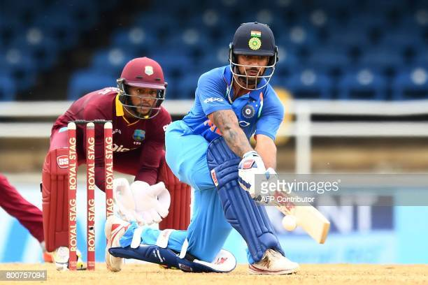 India's Shikhar Dhawan plays a shot as West Indies' wicketkeeper Shai Hope looks on during the second One Day International match between West Indies...