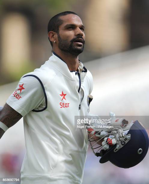 India's Shikhar Dhawan walks off after losing his wicket to England's James Anderson during day one of the first Investec test match at Trent Bridge...