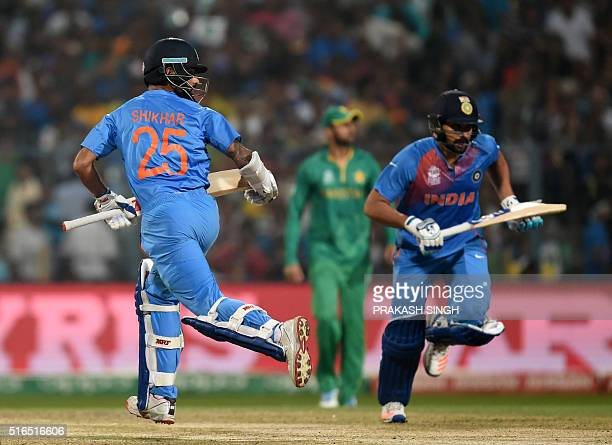 India's Shikhar Dhawanand Rohit Sharma run between the wickets during the World T20 cricket tournament match between India and Pakistan at The Eden...