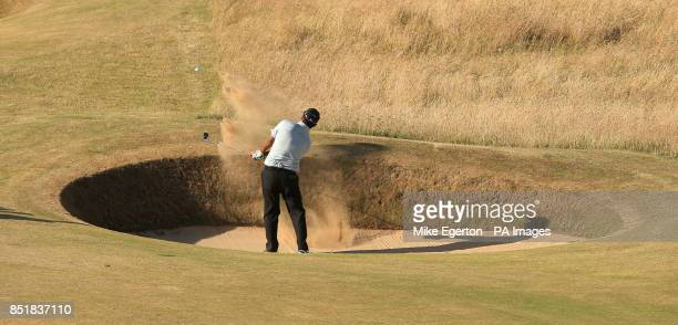 India's Shiv Kapur plays a bunker shot on the 10th hole during day one of the 2013 Open Championship at Muirfield Golf Club East Lothian