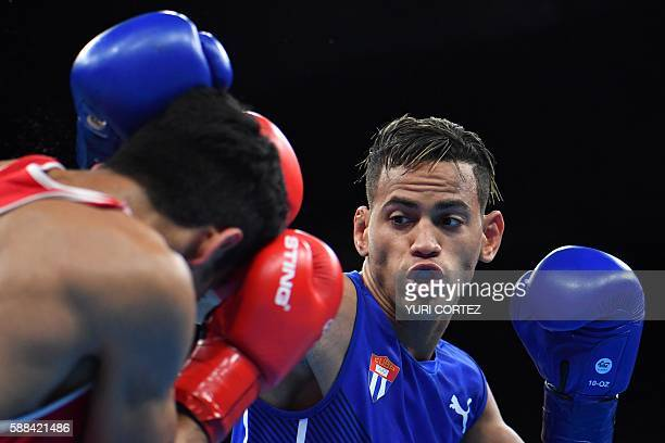 India's Shiva Thapa blocks punches from Cuba's Robeisy Ramirez during the Men's Bantam match at the Rio 2016 Olympic Games at the Riocentro Pavilion...