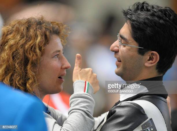 India's shooter Abhinav Bindra listens to his coach Gaby after winning the gold medal in the men's 10m air rifle shooting finals for the 2008 Beijing...