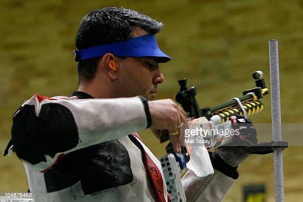 India's shooter Gagan Narang aims at the target during the 10M Air Rifle Men event of the Commonwealth Games at DrK Singh Shooting Range in New Delhi...