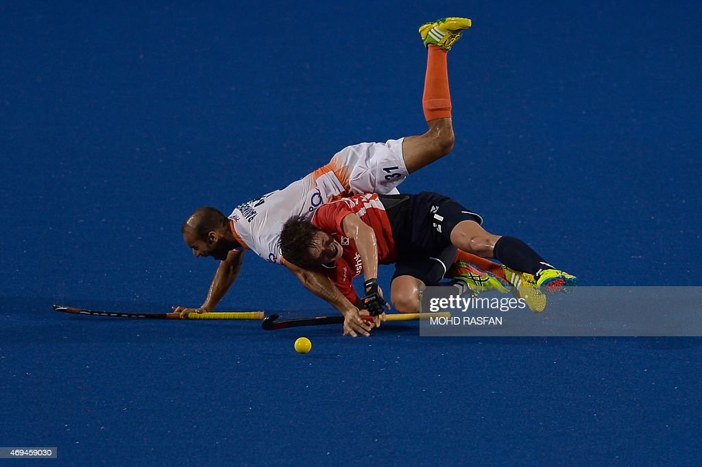India's Singh Ramandeep collides with Lee Seunghoon of South Korea during a third place playoff match at the Sultan Azlan Shah Cup men's field hockey...
