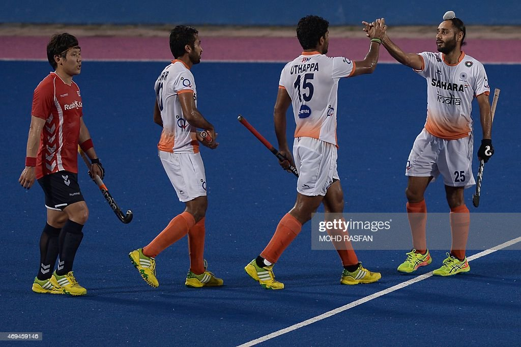 India's Singh Satbir celebrates after scoring a goal with his teammates during a third place playoff match against South Korea at the Sultan Azlan...