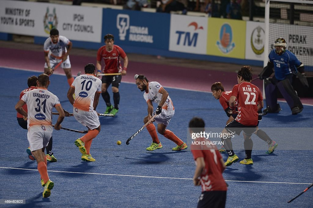 India's Singh Satbir vies for the ball against South Korea during a third place playoff match at the Sultan Azlan Shah Cup men's field hockey...