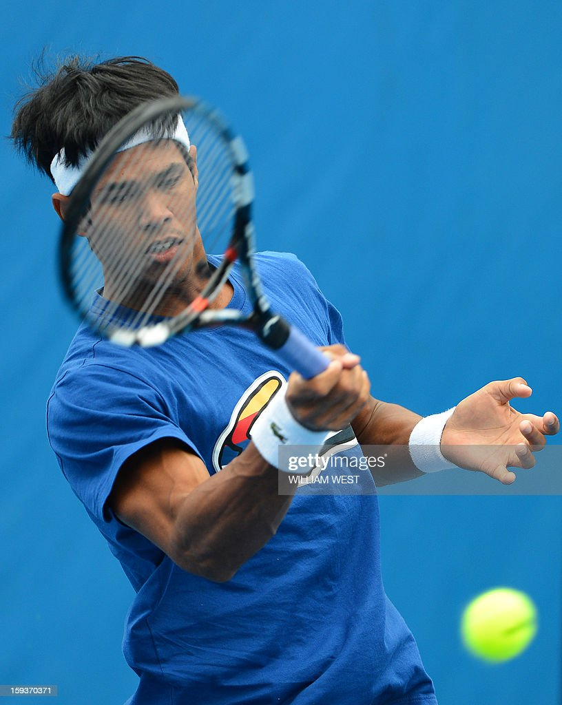 India's Somdev Devvarman plays a return during a practice session ahead of the 2013 Australian Open tennis tournament in Melbourne on January 13, 2013.