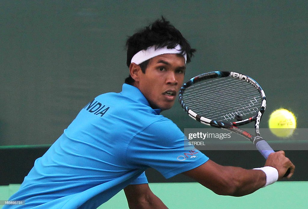 India's Somdev Devvarman plays a shot against Indonesia's David Agung Susanto during the Asia/Oceania Zone Group I Davis Cup singles play-off match at KSLTA stadium in Bangalore on April 7, 2013.