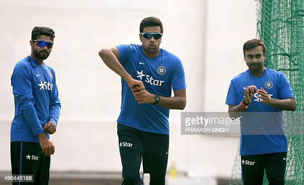 India's spin bowlers Ravindra Jadeja Ravichandran Ashwin and Amit Mishra bowl in the nets during a training session on the eve of the first Test...