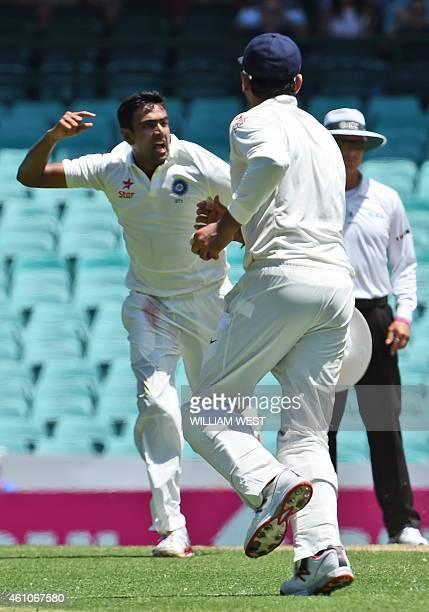 India's spinner Ravi Ashwin celebrates after dismissing Australian batsman David Warner on the first day of the fourth cricket Test at the Sydney...