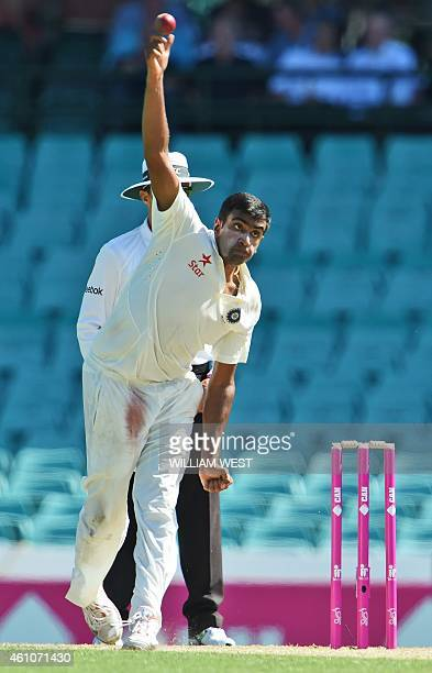 India's spinner Ravi Ashwin sends down a delivery to the Australian batsmen on the first day of the fourth cricket Test at the Sydney Cricket Ground...