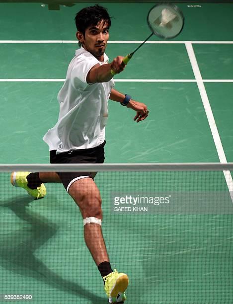 India's Srikanth Kidambi hits a return to Denmark's HansKristian Vittinghus during their men's singles semifinal at the Australian Open Badminton...