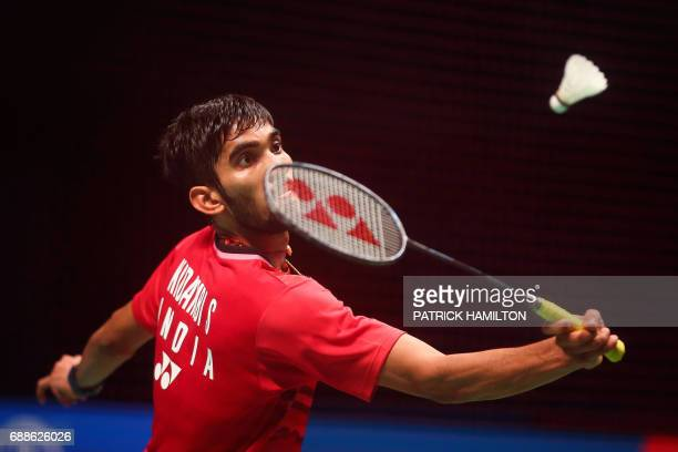 India's Srikanth Kidambi hits a shot during his men's singles Sudirman Cup badminton match against Chen Long of China at the Gold Coast Sports Centre...