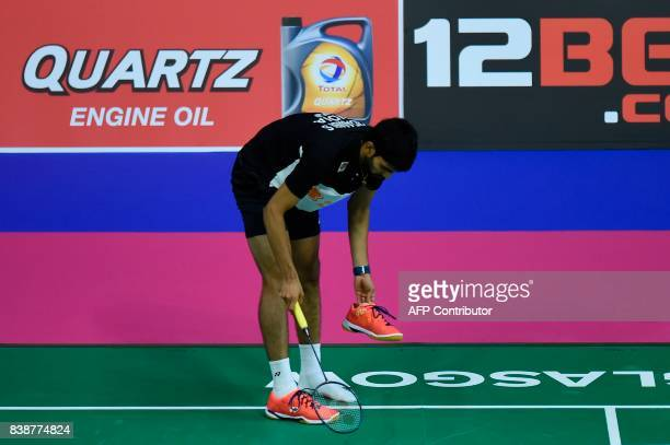 India's Srikanth Kidambi puts his show back on after losing it while playing against South Korea's Son Wan Ho during their quarterfinal men's singles...