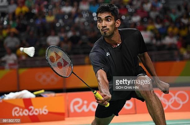 India's Srikanth Kidambi returns against China's Lin Dan during their men's singles quarterfinal badminton match at the Riocentro stadium in Rio de...
