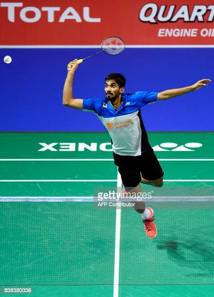 India's Srikanth Kidambi returns against Denmark's Anders Antonsen during their round three men's singles match during the 2017 BWF World...