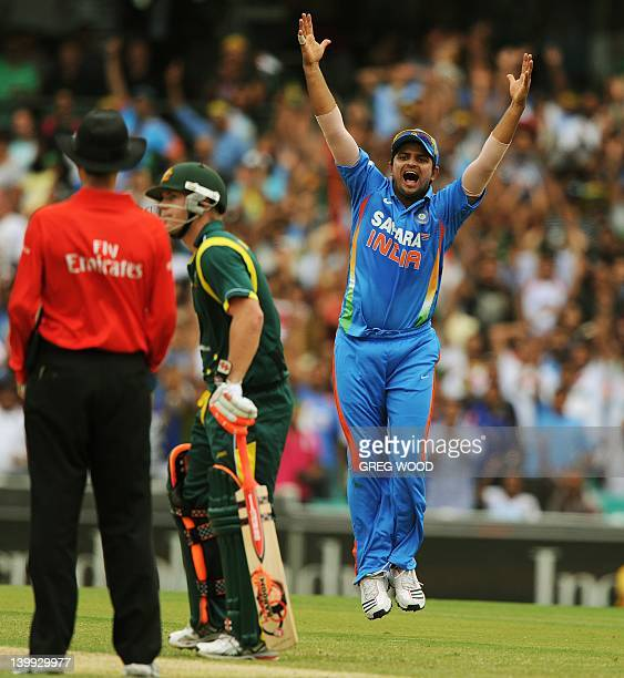 India's Suresh Raina appeals unsuccessfully for a dismissal following a delivery by bowler Ravi Ashwin during the one day international cricket match...