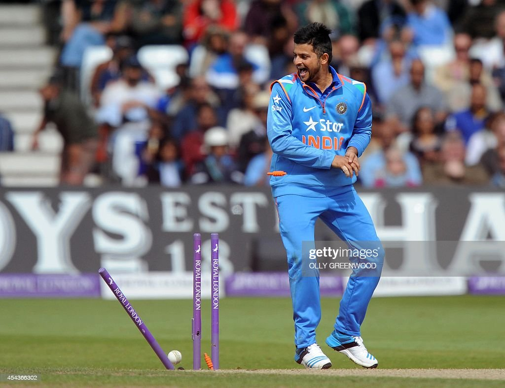 India's Suresh Raina celebrates as Mohit Sharma scores a direct hit to remove England's Ian Bell during the third one-day international cricket match between England and India at Trent Bridge in Nottingham, central England on August 30, 2014. AFP PHOTO / OLLY GREENWOOD ECB