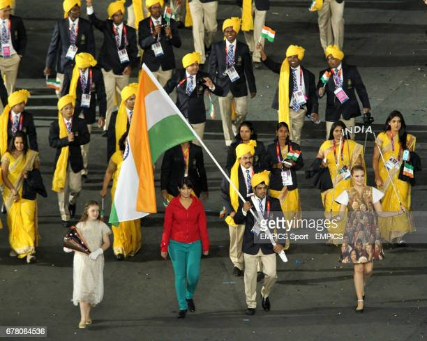 India's Sushil Kumar carries the flag as a member of the Olympics Opening Ceremony Madhura Nagendra of Bangalore joins in the athletes' parade