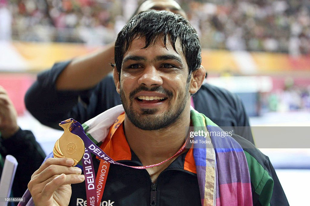 India's <a gi-track='captionPersonalityLinkClicked' href=/galleries/search?phrase=Sushil+Kumar+-+Wrestler&family=editorial&specificpeople=703954 ng-click='$event.stopPropagation()'>Sushil Kumar</a> celebrates aftre winning the gold in men's 84 free style wrestling final bout during the Commonwealth Games at the Indira Gandhi Sports Complex in New Delhi on Sunday, October 10, 2010.
