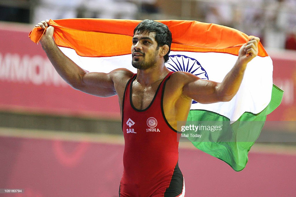 India's <a gi-track='captionPersonalityLinkClicked' href=/galleries/search?phrase=Sushil+Kumar&family=editorial&specificpeople=703954 ng-click='$event.stopPropagation()'>Sushil Kumar</a> celebrates aftre winning the gold in men's 84 free style wrestling final bout during the Commonwealth Games at the Indira Gandhi Sports Complex in New Delhi on Sunday, October 10, 2010.