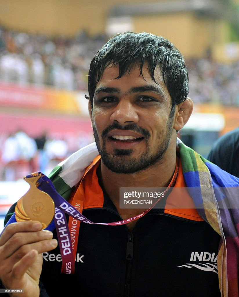 India's <a gi-track='captionPersonalityLinkClicked' href=/galleries/search?phrase=Sushil+Kumar+-+Wrestler&family=editorial&specificpeople=703954 ng-click='$event.stopPropagation()'>Sushil Kumar</a> poses with his gold medal during the men's 66kg freestyle wrestling awards ceremony during the Commonwealth Games in New Delhi on October 10, 2010. The Commonwealth Games are taking place in the Indian capital from October 3-14.