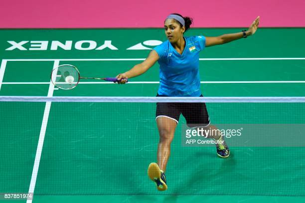 India's Tanvi Lad returns against South Korea's Sung Ji Hyun during their round two women's singles match during the 2017 BWF World Championships of...