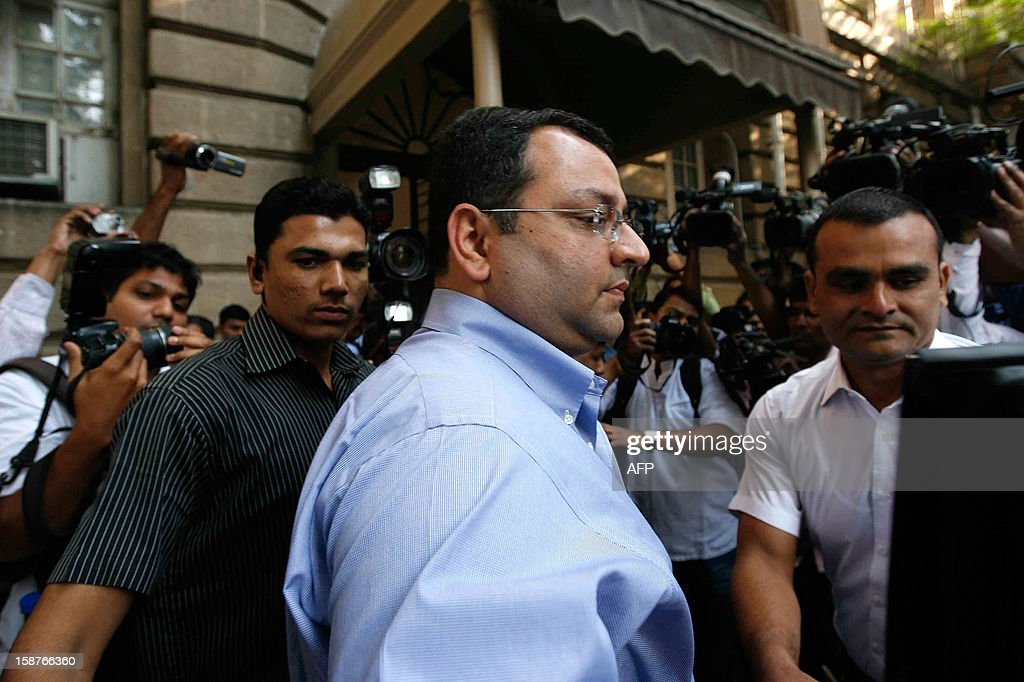 India's Tata Group's new Chairman Cyrus Mistry (C) walks into the company head office in Mumbai on December 28, 2012. The head of India's Tata Group, Ratan Tata, quietly handed over the reins of the business empire on his 75th birthday December 28, as he basked in the plaudits for turning the organisation into a global power. Tata, who steered the group for 21 years as chairman, has been credited with transforming it into a streamlined conglomerate of more than 100 companies and earning a global reputation for eye-catching acquisitions of Western firms.