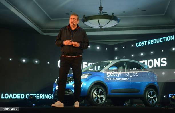 India's Tata Motors Chief Executive Officer Guenter Butschek speaks during the launch of the new company's car 'Nexon' model in Mumbai on September...