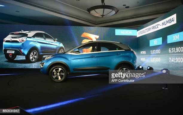 India's Tata Motors new car 'Nexon' is seen on display during its launch in Mumbai on September 21 2017 / AFP PHOTO / PUNIT PARANJPE