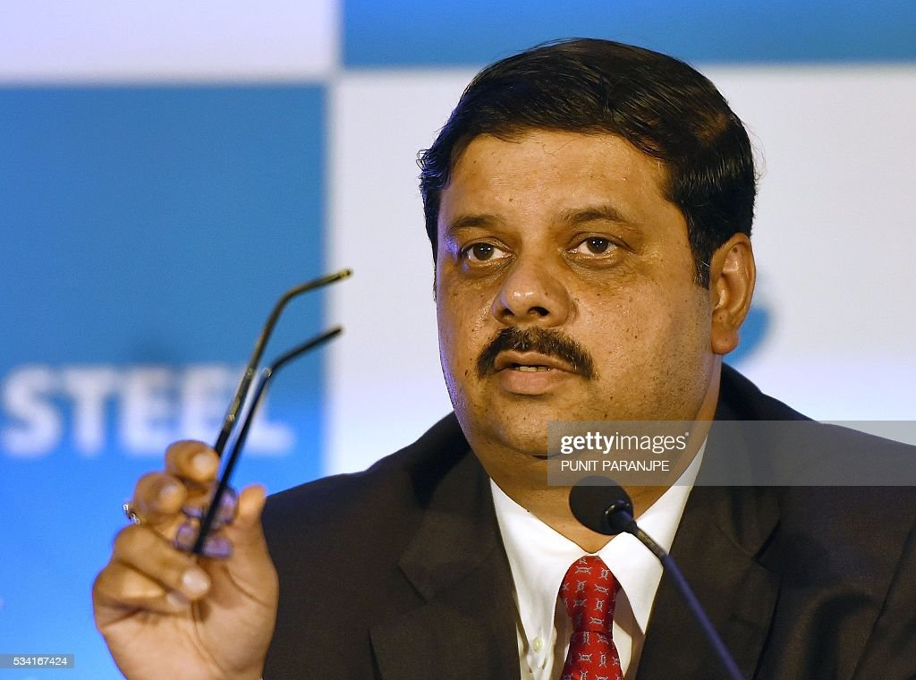 India's Tata Steel group's Managing Director and Chief Financial Officer Koushik Chatterjee gestures as he speaks during a news conference in Mumbai on May 25, 2016. India's Tata Steel said that it had yet to shortlist any bidders for the sale of its loss-making British assets but that it hoped to close a deal soon. / AFP / PUNIT