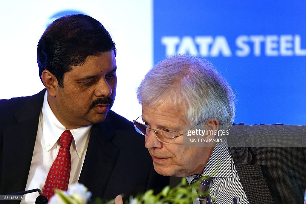 India's Tata Steel group's Managing Director and Chief Financial Officer Koushik Chatterjee (L) speaks with Hans Fischer, Chief Executive Officer of Tata Steel Europe during a news conference in Mumbai on May 25, 2016. India's Tata Steel said that it had yet to shortlist any bidders for the sale of its loss-making British assets but that it hoped to close a deal soon. / AFP / PUNIT